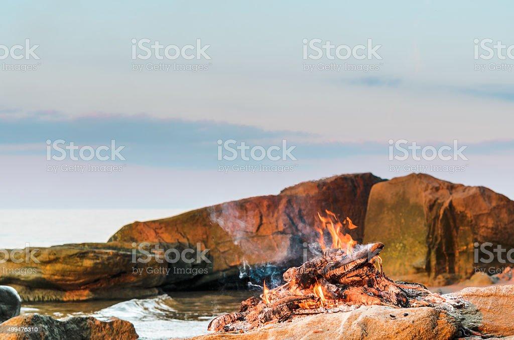 Campfire on the seashore stock photo
