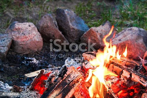 istock A campfire with a ring of stones around it 821588944