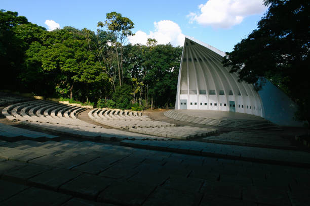 Campinas, SP, Brazil - April 26th, 2009: Acoustic shell of the Taquaral Lagoon (Parque Portugal). Outdoor stage for shows amidst the green of the park, named Beethoven Auditorium, is a replica of Lincoln Park in the USA. Acoustic shell of the Taquaral Lagoon (Parque Portugal). Outdoor stage for spectacles amidst the green of the park, named Beethoven Auditorium, is a replica of Lincoln Park in the USA and has a capacity of about 2 thousand people. amidst stock pictures, royalty-free photos & images