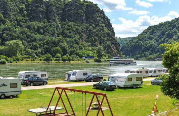 Camping and caravans beside the River Rhine, Germany stock photo