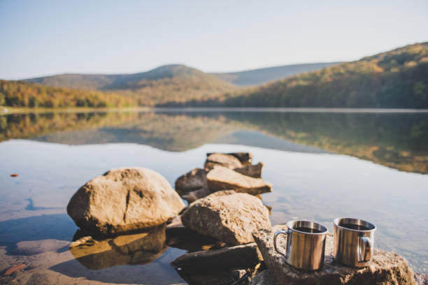 Camping And Drinking Morning Coffee near a lake stock photo