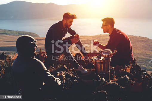 camping and drinking tea on mountain