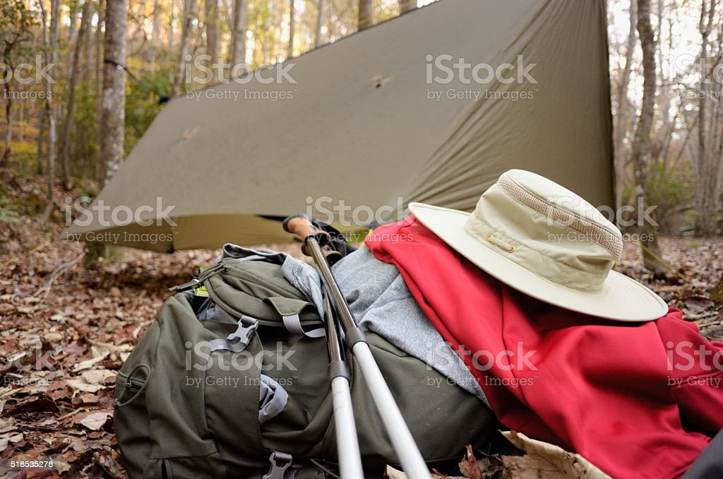 Camping and hiking gear in campsite stock photo