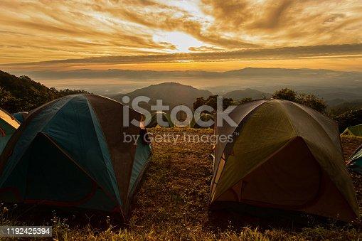 Camping and tents with mist and mountain at Doi Ang Khang ,Chiang Mai