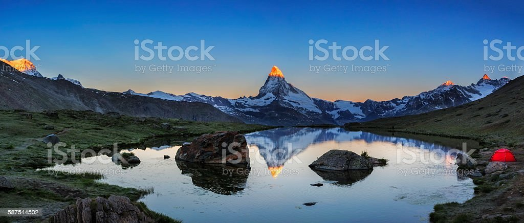 Camping at Matterhorn during sunrise with Stellisee in foreground stock photo