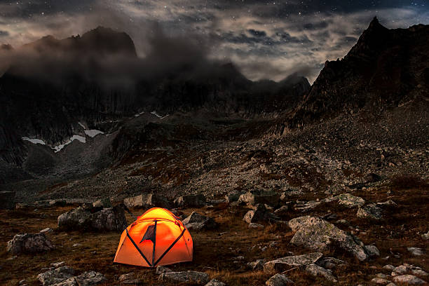 Camping at night in the mountains stock photo