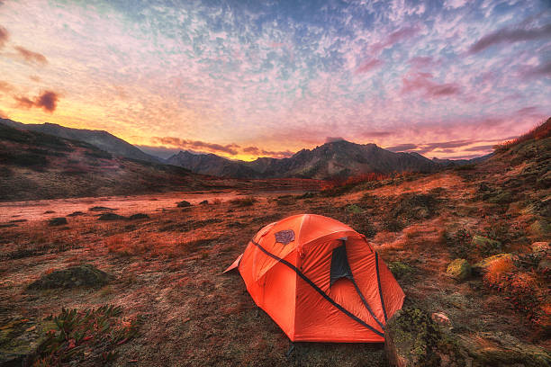 Camping at sunrise in the mountains stock photo