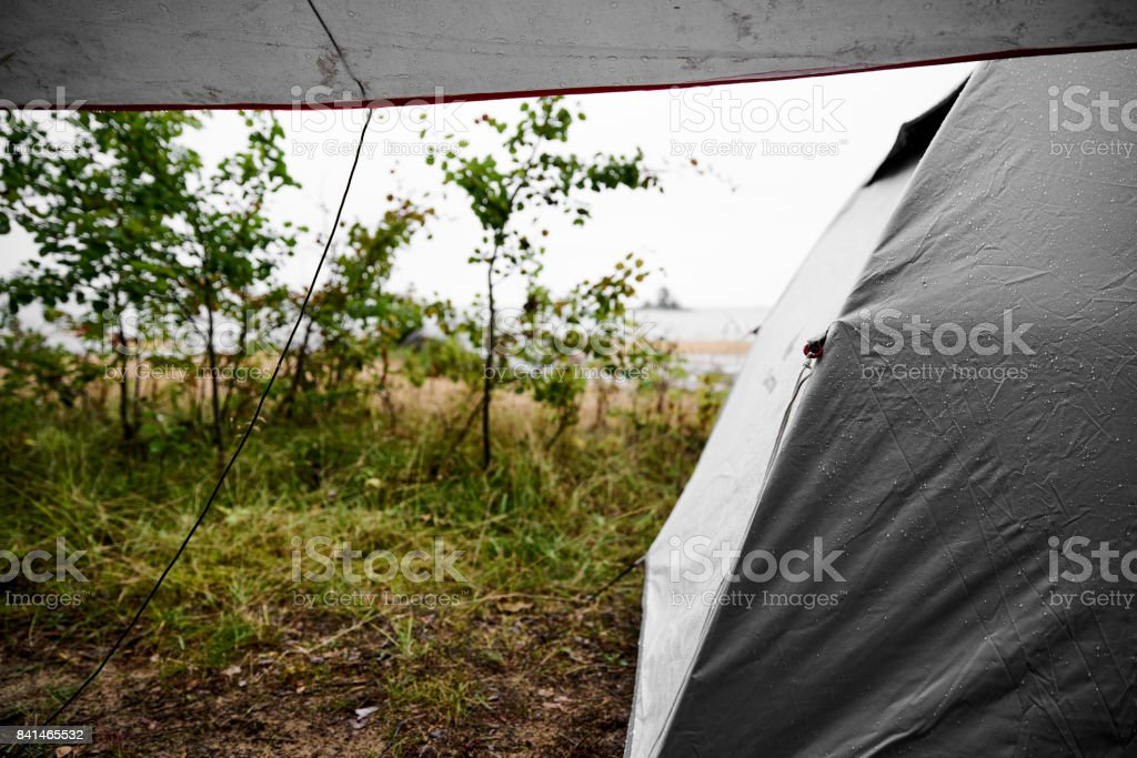 It was a rainy day at the beach and we had to hide under our tarp.