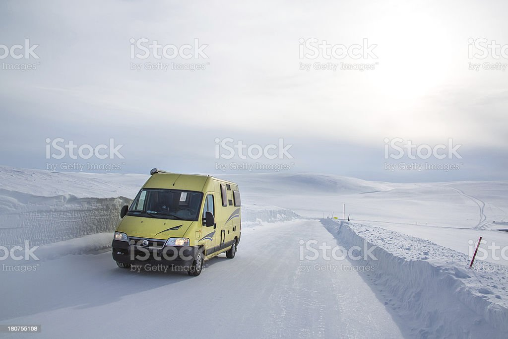 Camping bus on a winter road  in Norway royalty-free stock photo