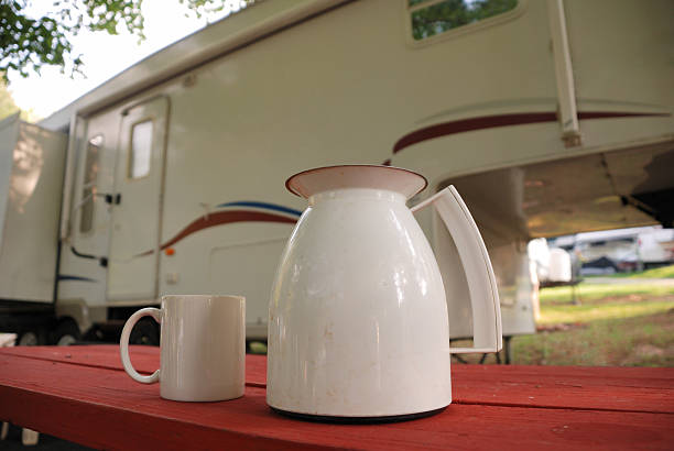 Camping: Coffee Pot and Cup stock photo