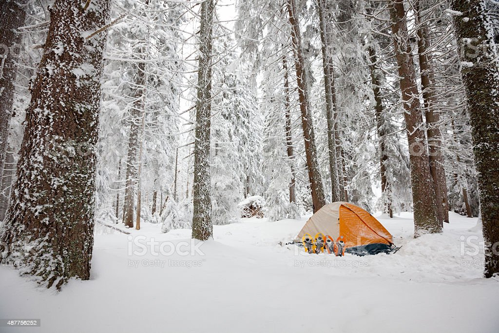 Camping during winter hiking in Carpathian mountains stock photo