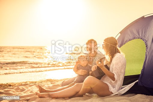 istock Camping family at the beach 506061828
