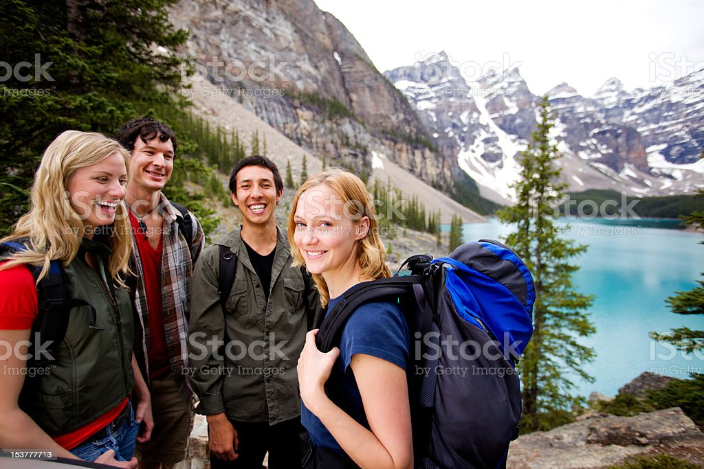Camping Friends in Mountains stock photo