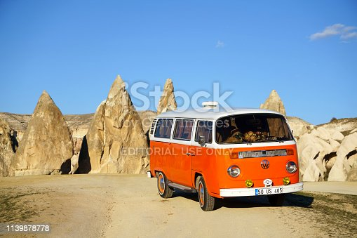 Cappadocia, Turkey - March 19,2019:Parked model T2 Volkswagen Van to camp on the front of the Fairy Chimneys.