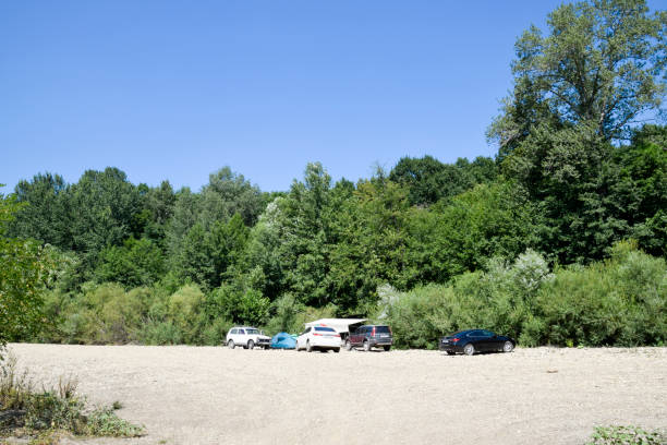 Camping in nature. Departure by car to the nature to the river in the forest. stock photo