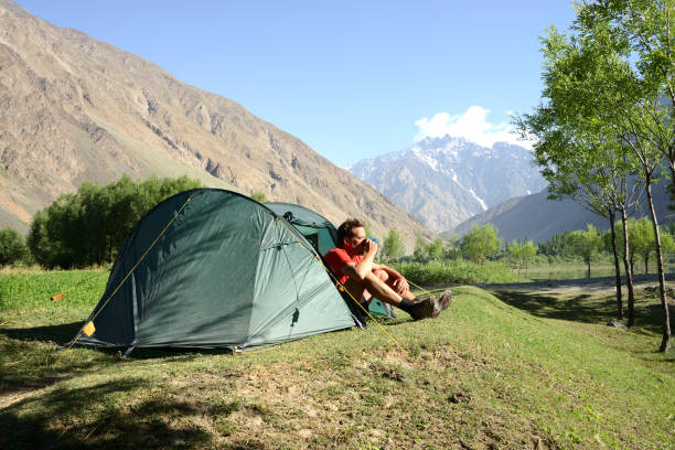 Camping in the Wakhan valley with Afghanistan in the background, Pamir Mountain Range, Tajikistan stock photo