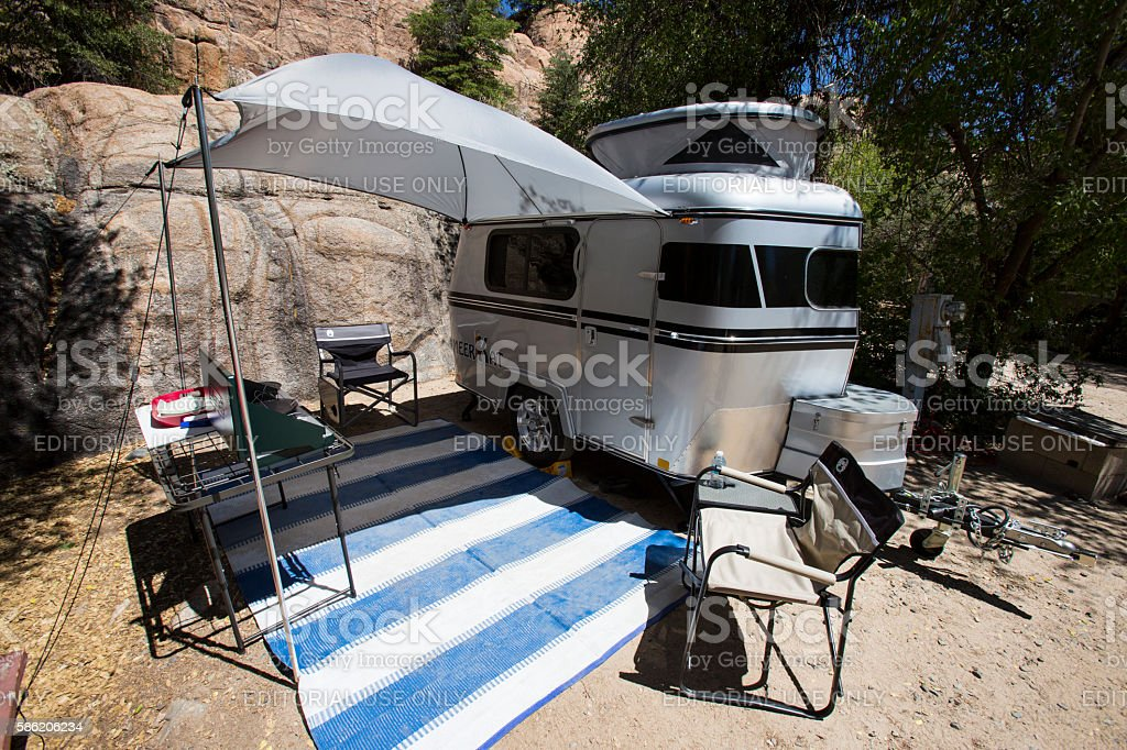 Camping in tiny Meerkat camper stock photo