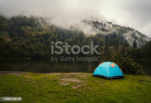 Camping tent in pine tree forest by the lake near Artvin, Turkey