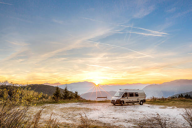 Camping Motor Home parked outdoor in the mountains stock photo