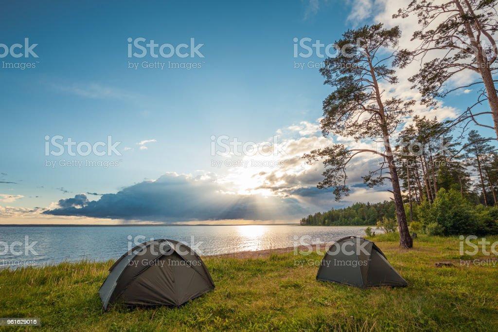 Camping near lake stock photo