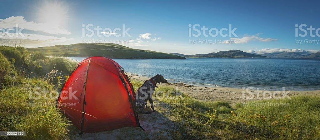 Camping on idyllic beach dunes overlooking ocean island panorama stock photo