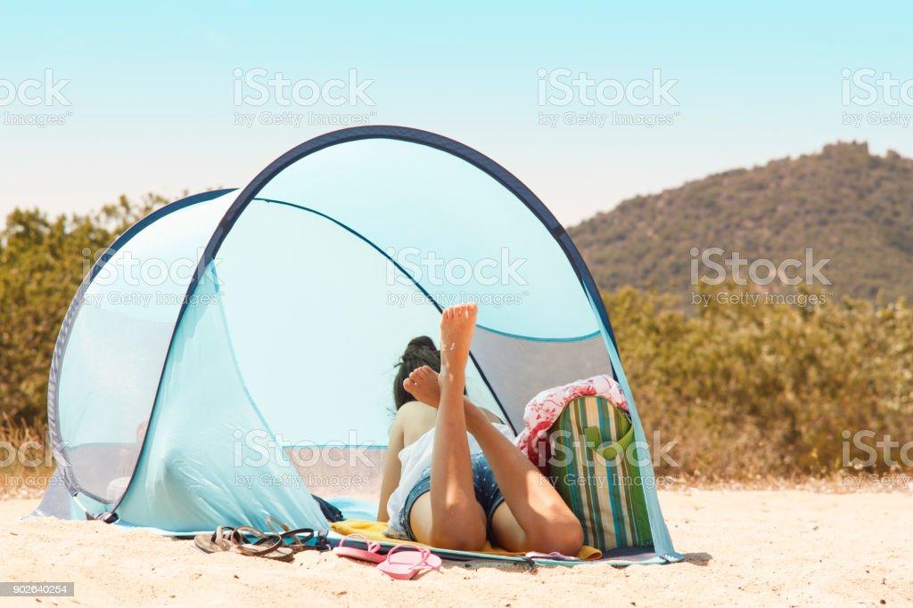 Camping on sandy beach stock photo