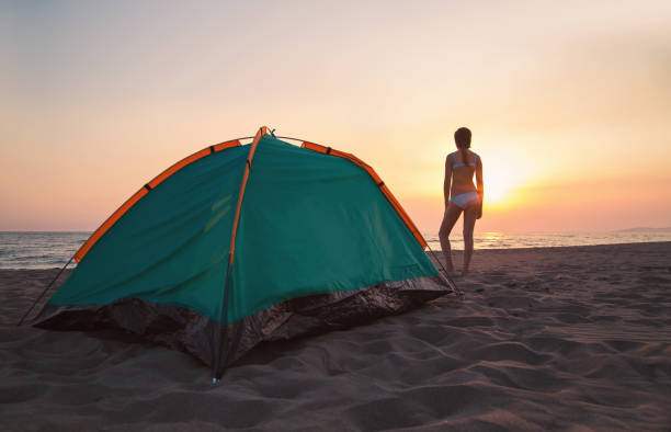 Camping on the beach and beautiful sunset stock photo