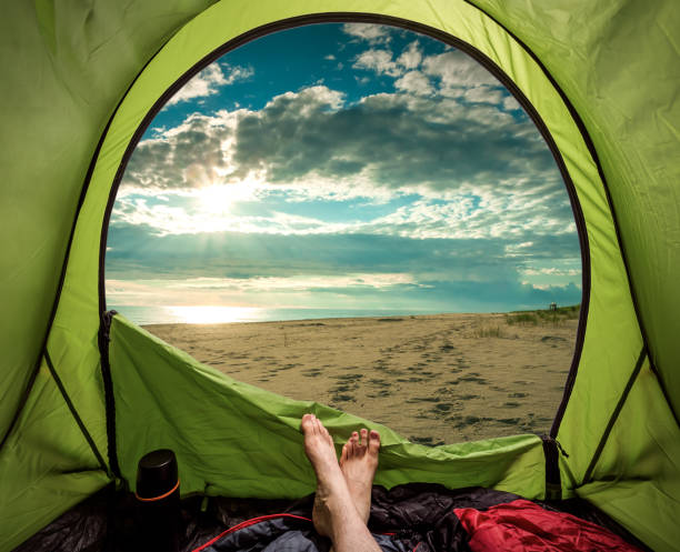 Camping on the beach in summer at sea stock photo