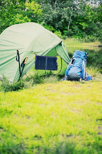 Camping On The River Bank The Solar Panel Hangs On The Tent Stock Photo - Download Image Now - iStock