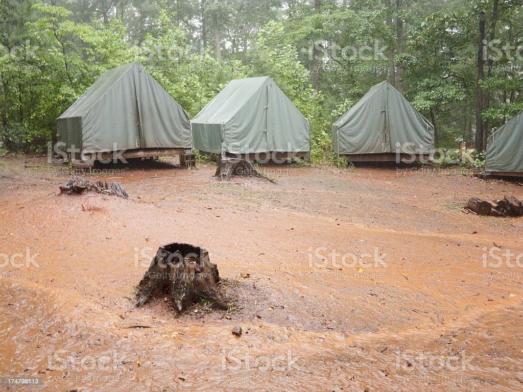 Seen here is a group of closed platform tents during a rainstorm.