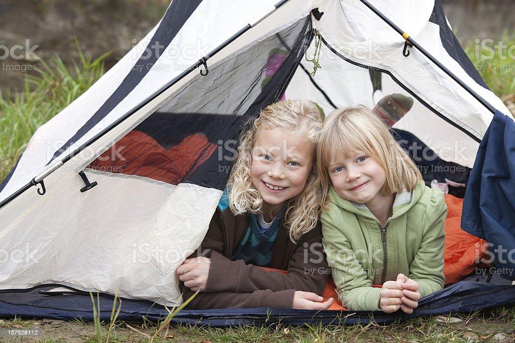 Camping sisters royalty-free stock photo