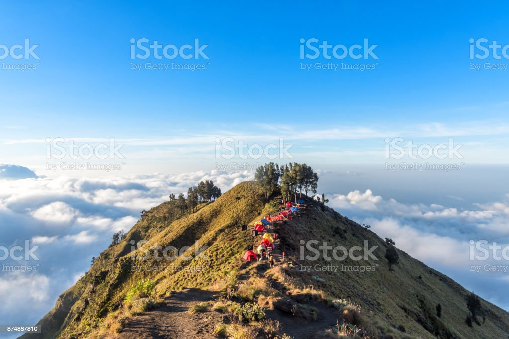 Camping site on crater rim of Mount Rinjani at sunset. Lombok Island, Indonesia. stock photo