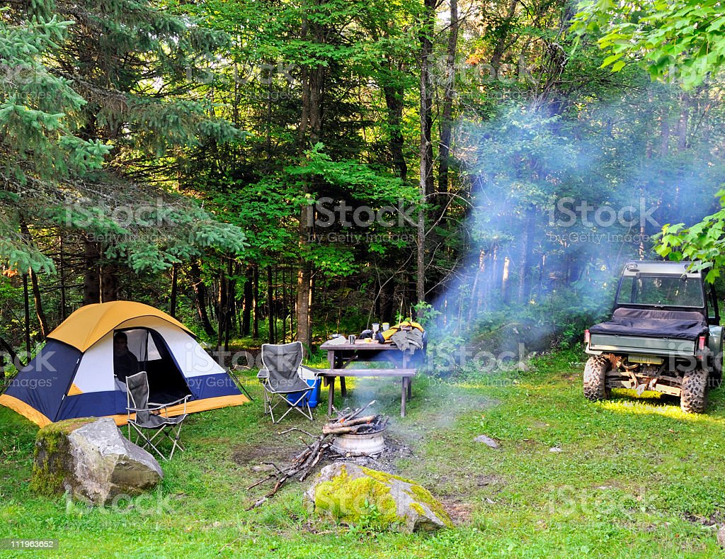 camping site with smoke from a fire royalty-free stock photo