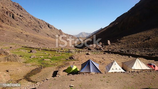 Imlil/Morocco - 09.30.2019: Camping spot with tents in front of Refuge Toubkal Les Mouflons, in Atlas Mountains