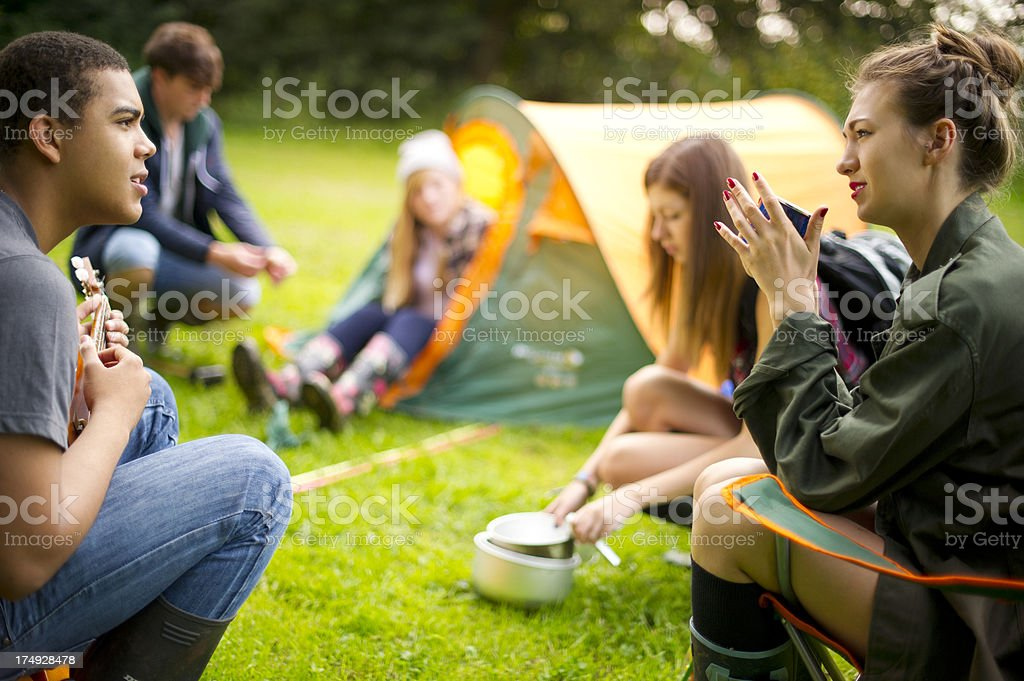 camping teens stock photo