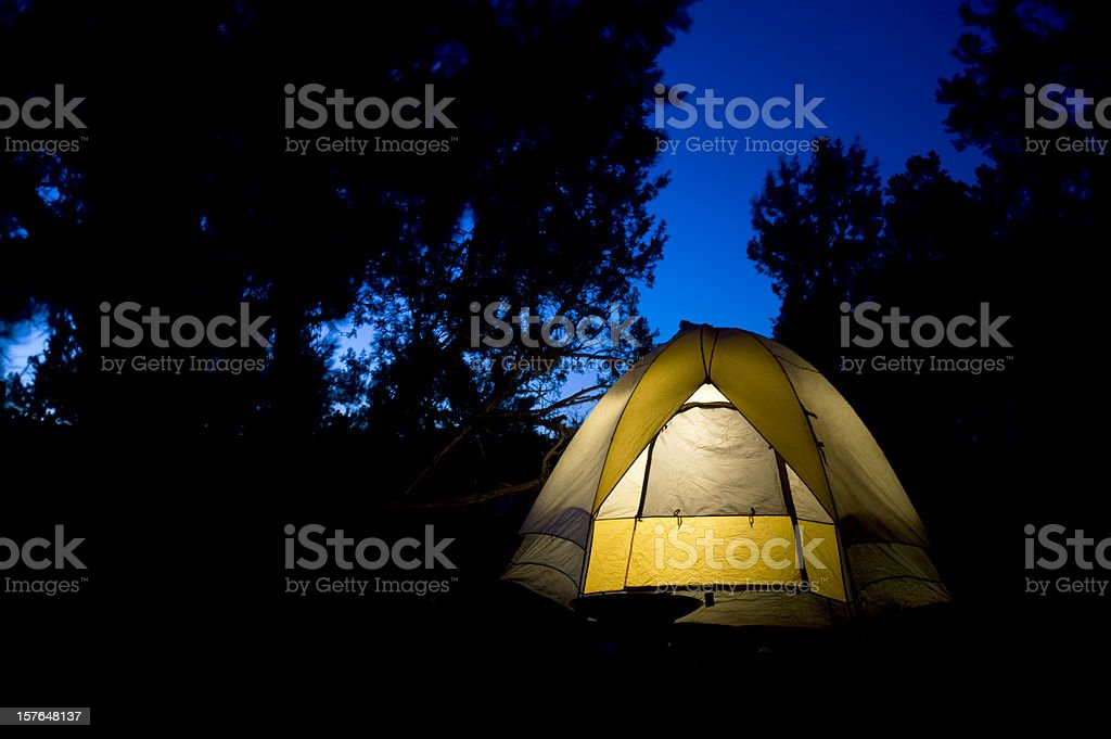 Camping Tent Glowing at Night royalty-free stock photo