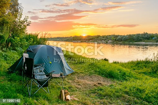 istock Camping tent in a camping in a forest by the river 911995140