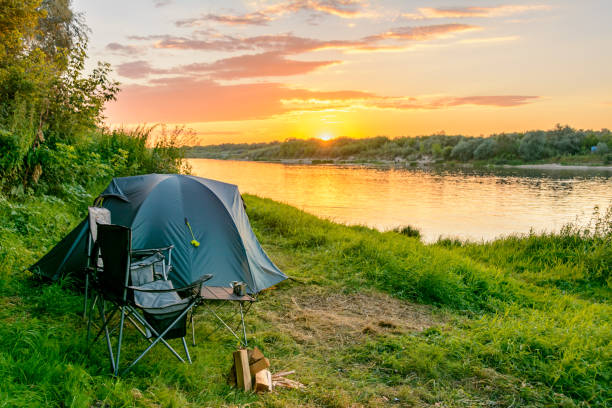 camping tent in a camping in a forest by the river - camping stock photos and pictures
