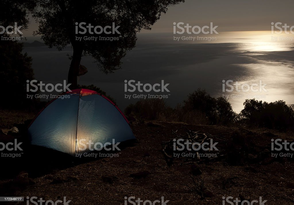 Camping tent in night by mediterranean sea royalty-free stock photo