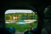 Camping tent is setup by the lake