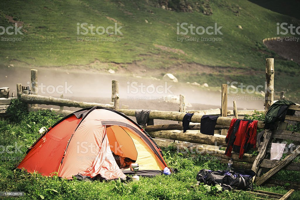 Camping tent near a village in the misty mountains royalty-free stock photo