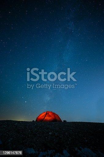 orange camping tent night stars