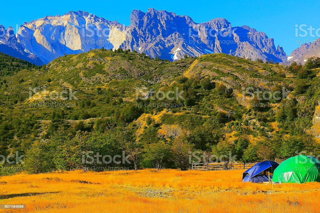 Camping tents, Chilean Patagonia steppe landscape sunrise, Torres Del Paine stock photo