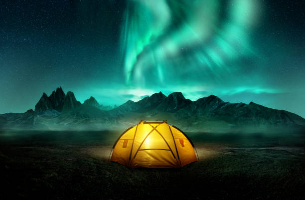 Camping Under Dancing Green Aurora Northern Lights stock photo