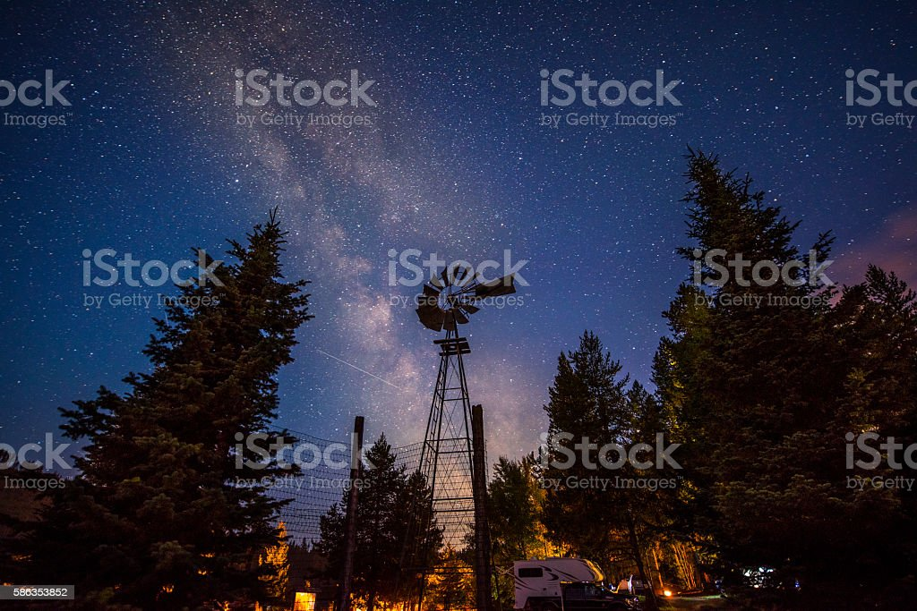 Camping under night sky stock photo