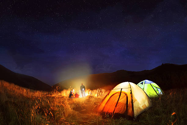 Camping Under The Stars At Night Stock Photo
