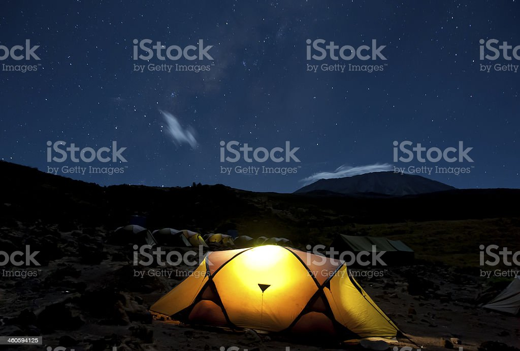 Kikelelwa Cave campsite on Rongai Route at night with Kilimanjaro...