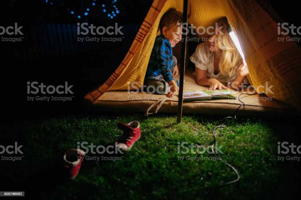 Camping with my mom Portrait of a mother and son camping in an improvised tent  2-3 Years Stock Photo