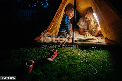 Portrait of a mother and son camping in an improvised tent