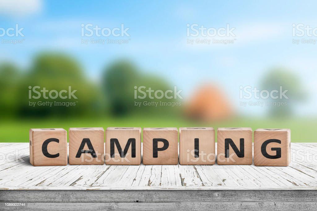 Camping word on a wooden cube sign stock photo